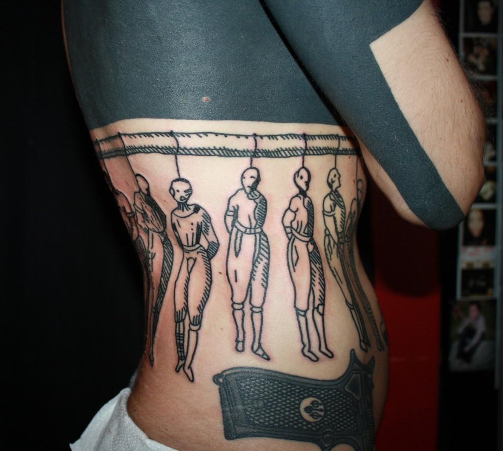 Black work tattoo by Duncan X