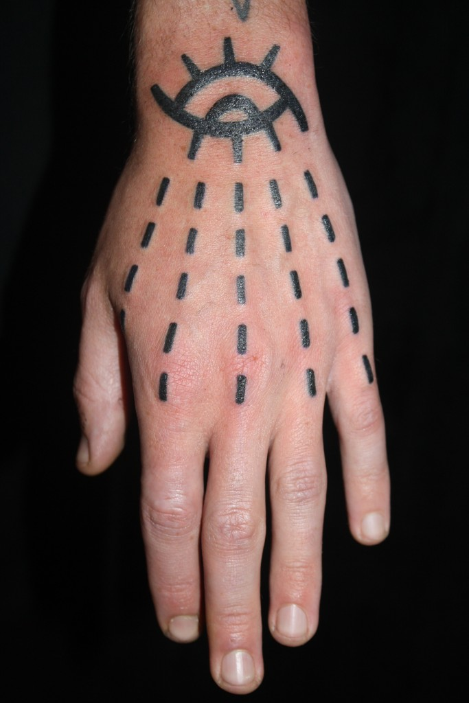 Black work hand tattoo by Duncan X