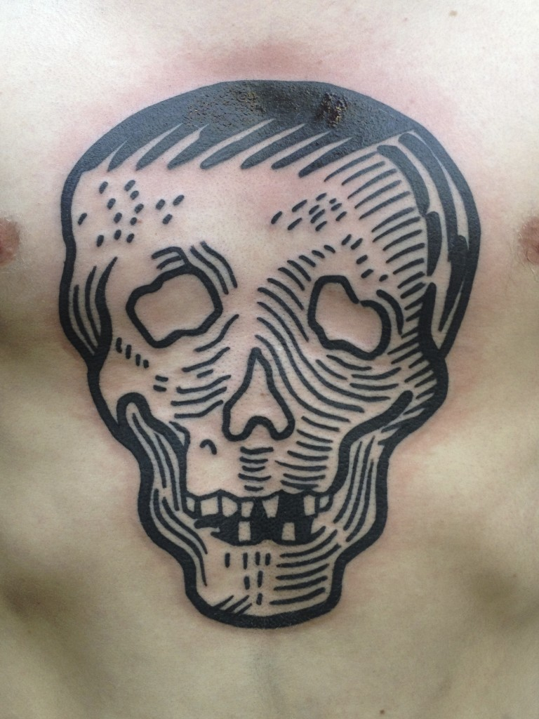 Skull chest tattoo by Duncan X