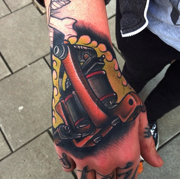 Hand tattoo by Mike Stockings