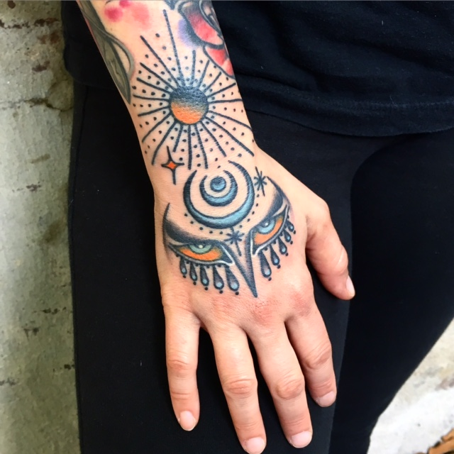 Hand tattoo by Eva Jean
