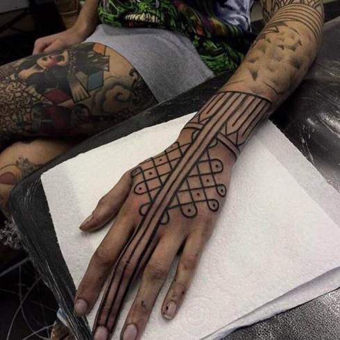Hand tattoo by Kieran Williams